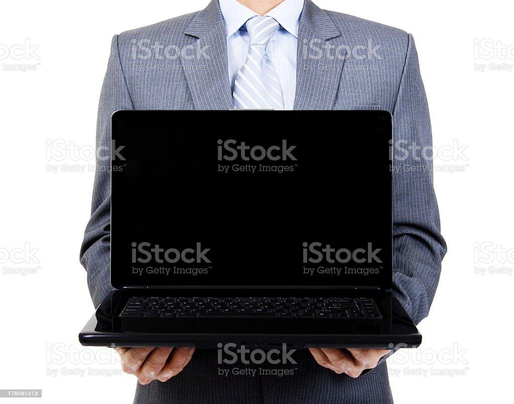 Business man holding blank laptop royalty-free stock photo