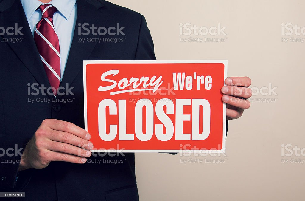 Business Man holding Closed Sign royalty-free stock photo