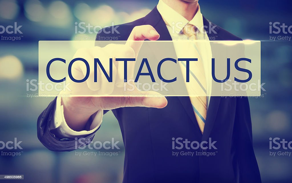 Business man holding Contact Us stock photo