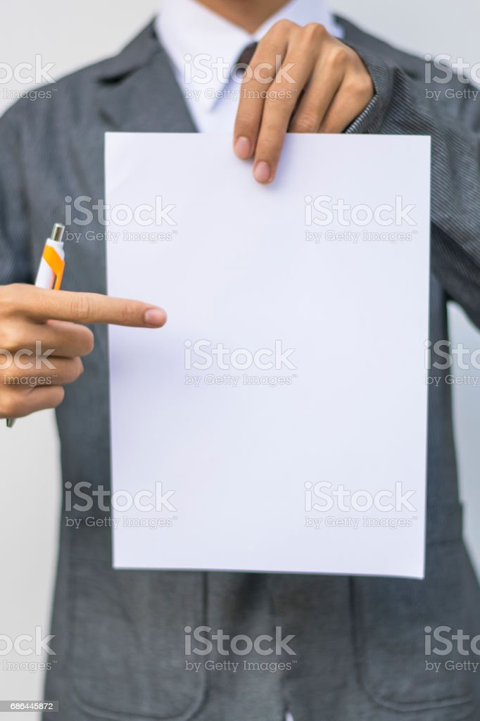 Business man holding empty paper stock photo