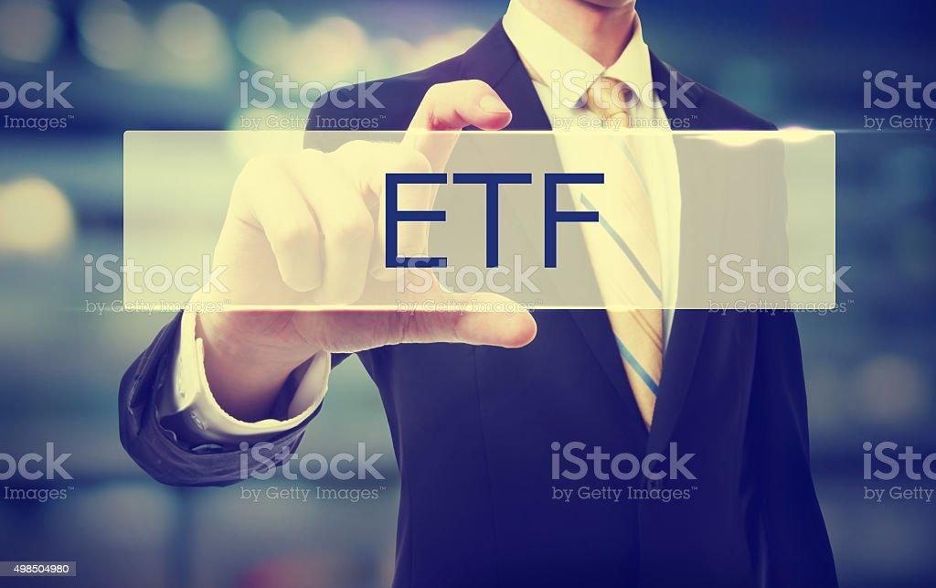 Business man holding ETF stock photo