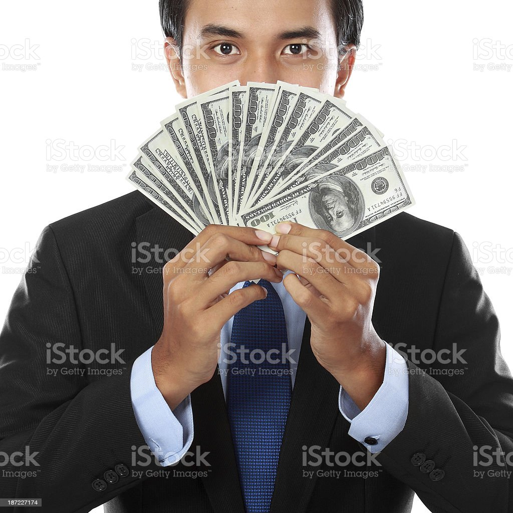 business man holding money royalty-free stock photo