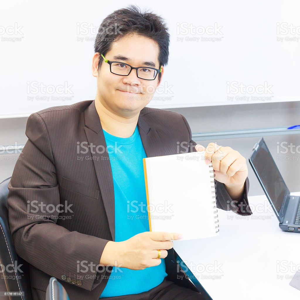 business man holding notebook stock photo