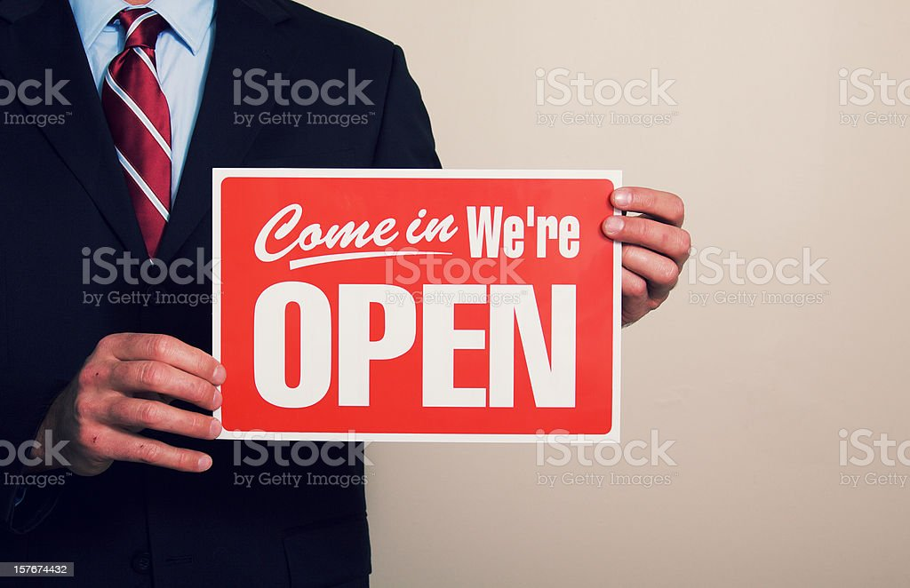 Business Man Holding Open Sign royalty-free stock photo