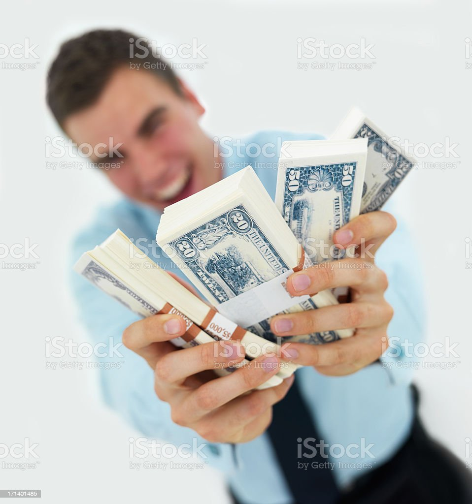 Business man holding out money isolated on white background royalty-free stock photo