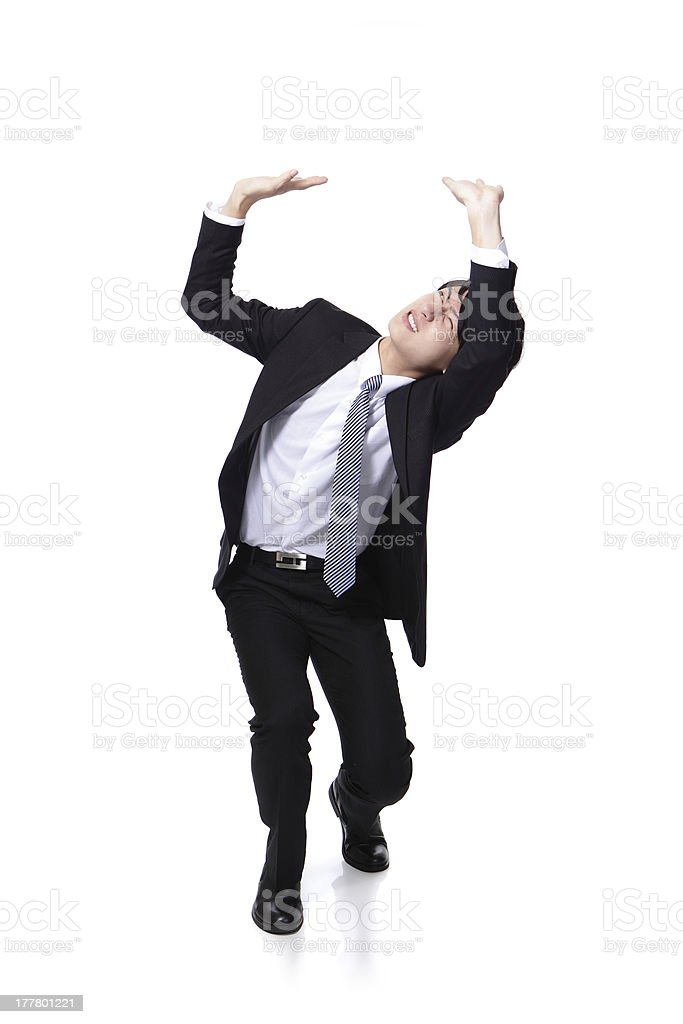 business man holding something heavy above head stock photo