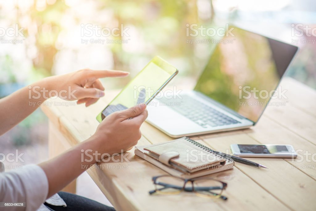 Business man holding tablet and working with laptop and smart phone stock photo