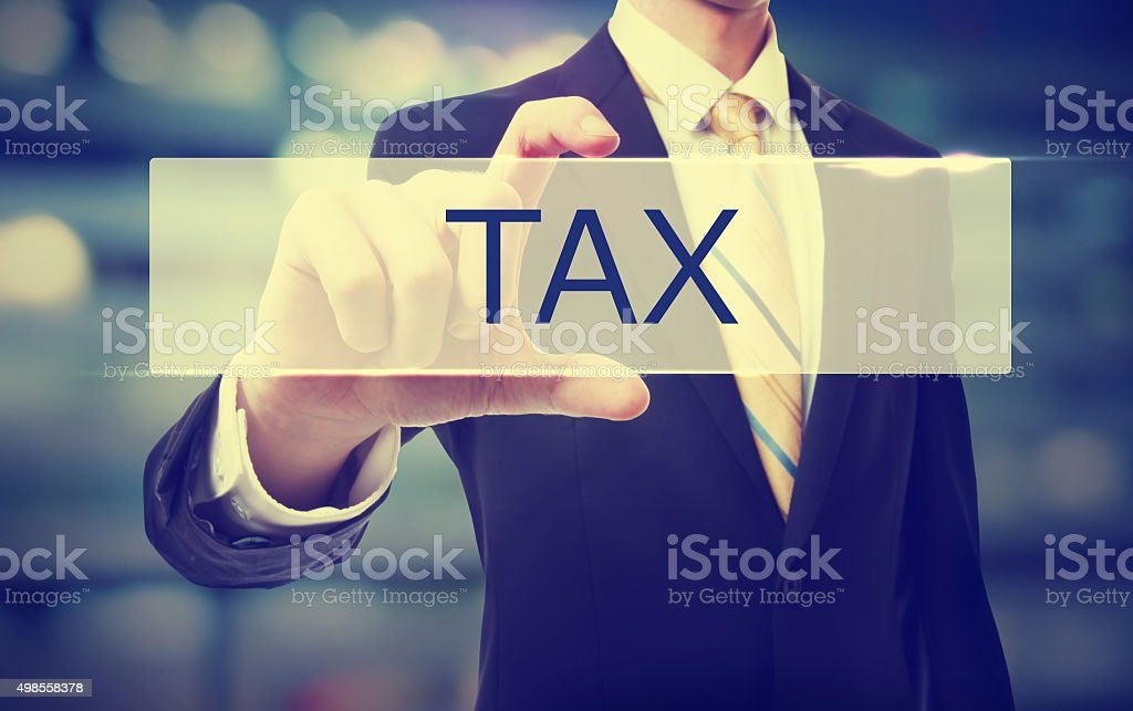 Business man holding TAX stock photo