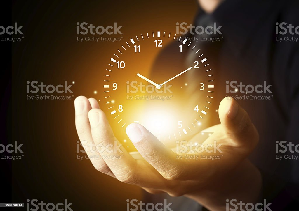 Business man holding times stock photo