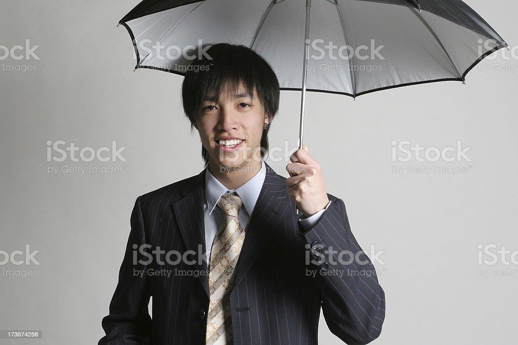 Business man holding umbrella stock photo