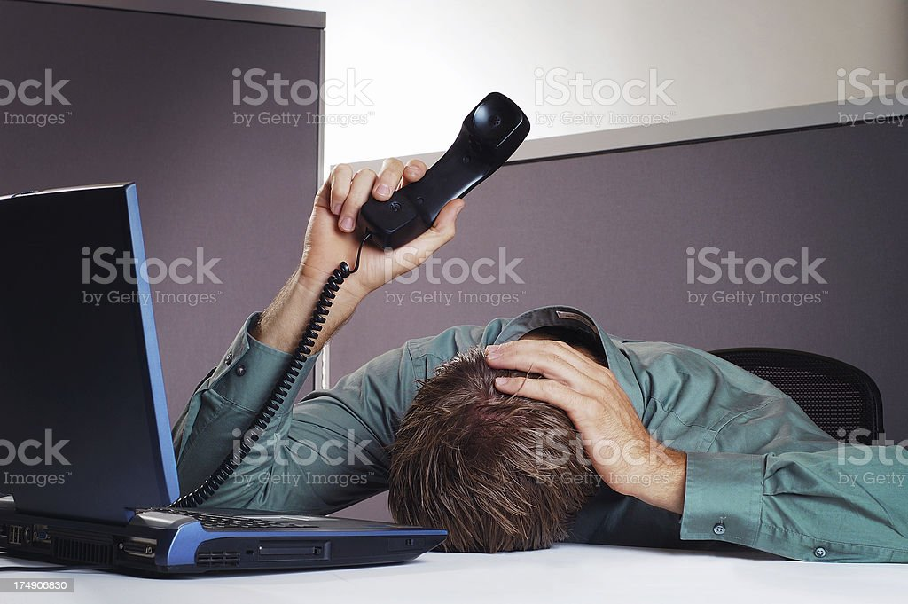 Business man holds head and phone in the air stock photo
