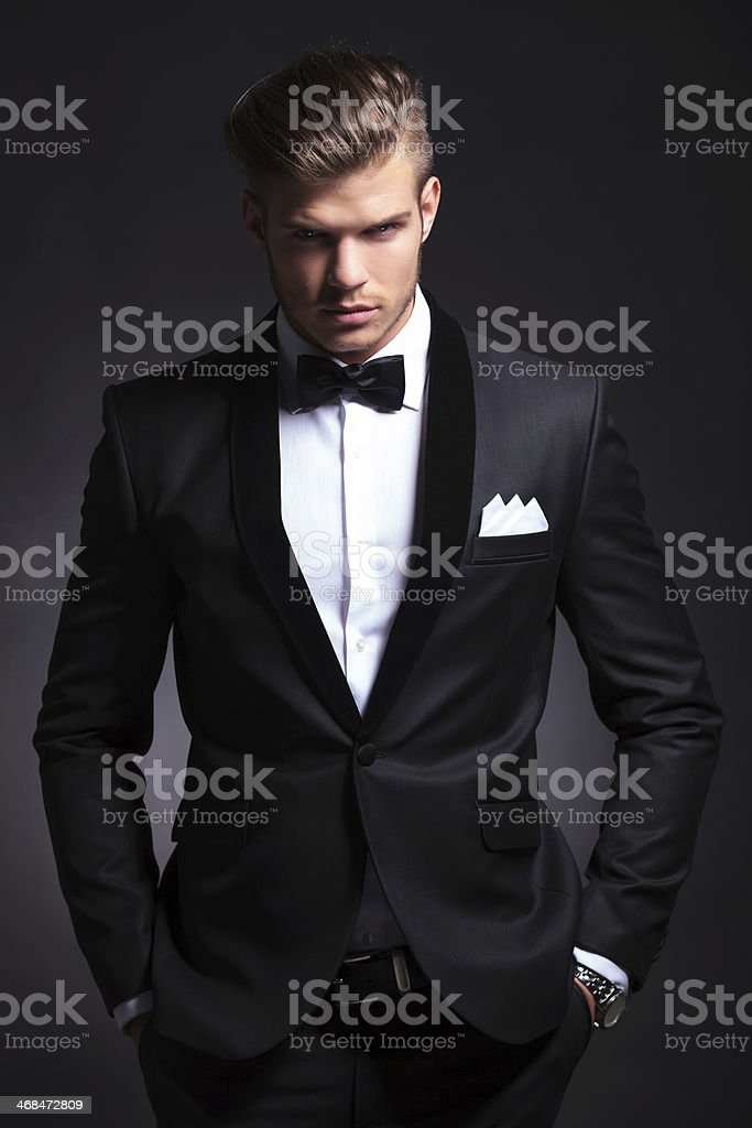 business man holds his hands in pockets stock photo