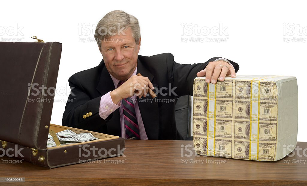 Business man in a black suit with one million dollars stock photo