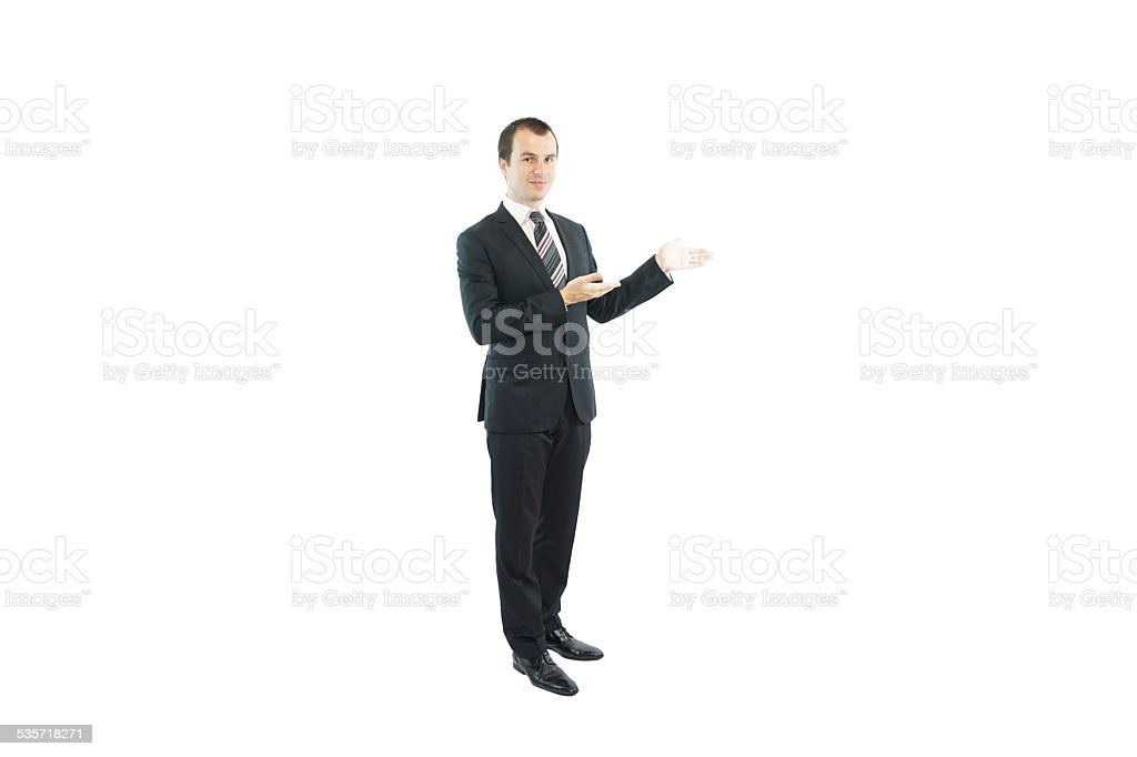 Business man in a suit showing an offer stock photo