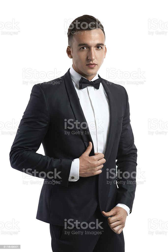 business man in a suit straightens his jacket stock photo