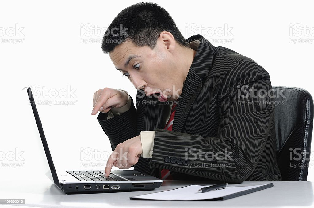 Business Man in Black typing with two Fingers royalty-free stock photo