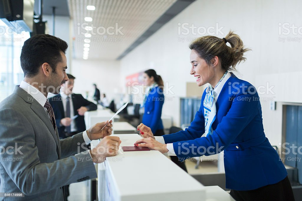 Business man in check-in counter with boarding pass. stock photo