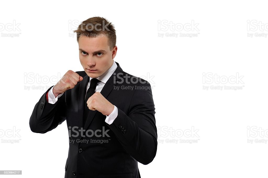 Business man in fighting position. stock photo