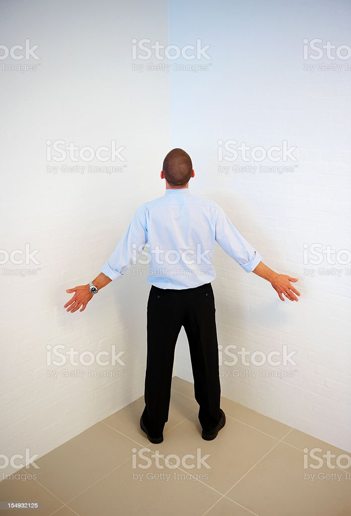 Business man in front of blocking wall stock photo
