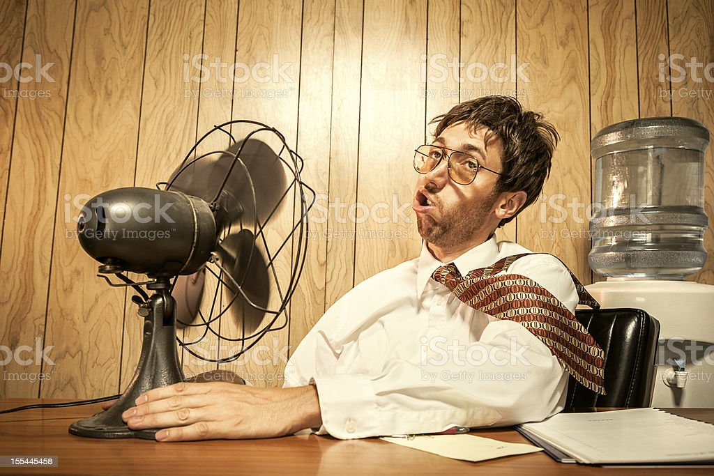 Business Man in Office With Fan stock photo