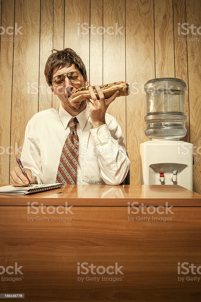 Business Man in Office With Sandwich stock photo