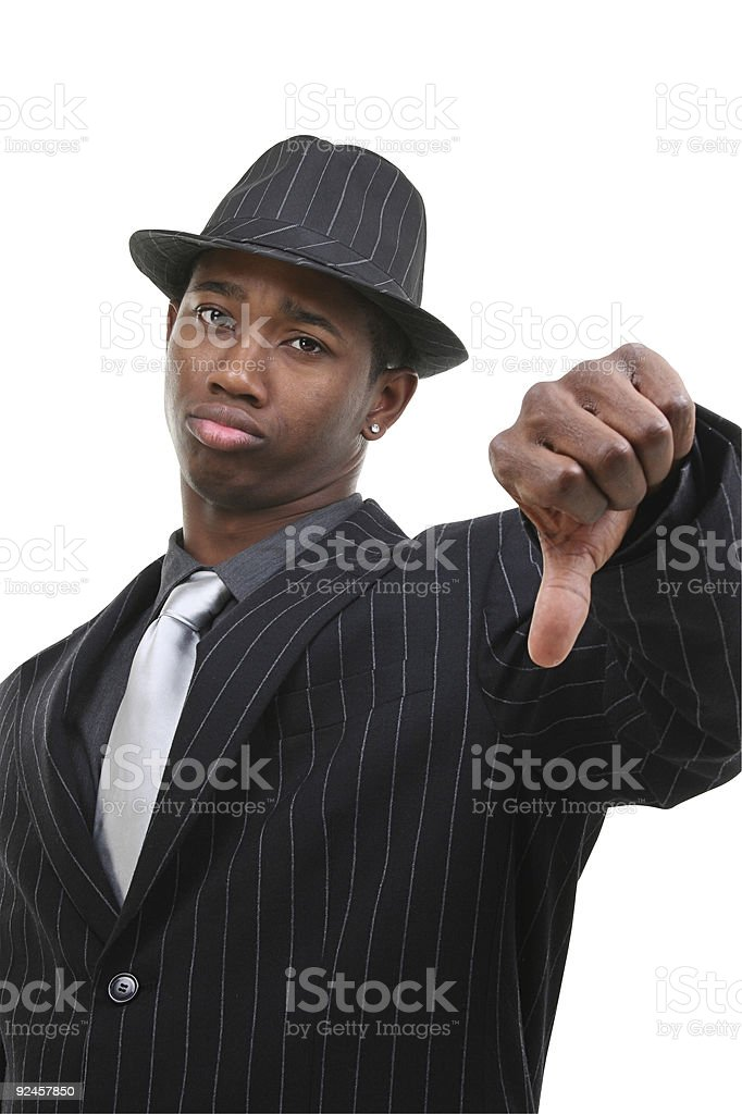 Business Man In Pin Striped Suit & Hat Giving Thumbs Down royalty-free stock photo