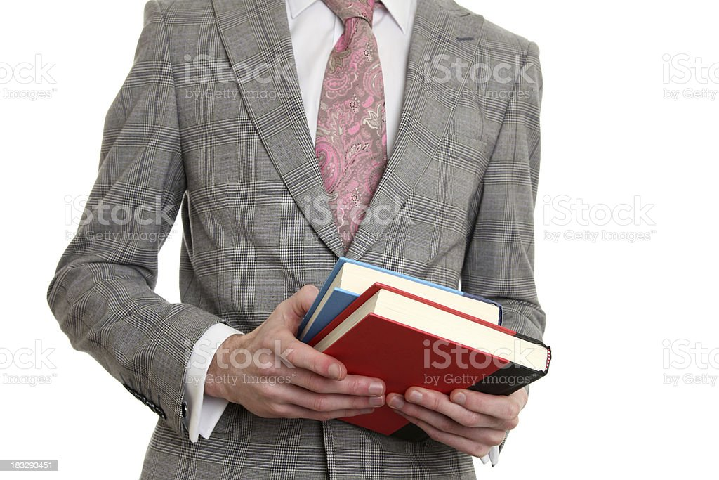 business man in suit holding books royalty-free stock photo