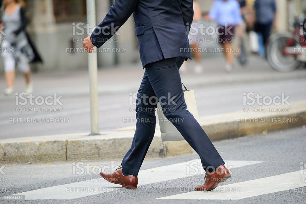 Business man in suit on street, with shopping bag stock photo
