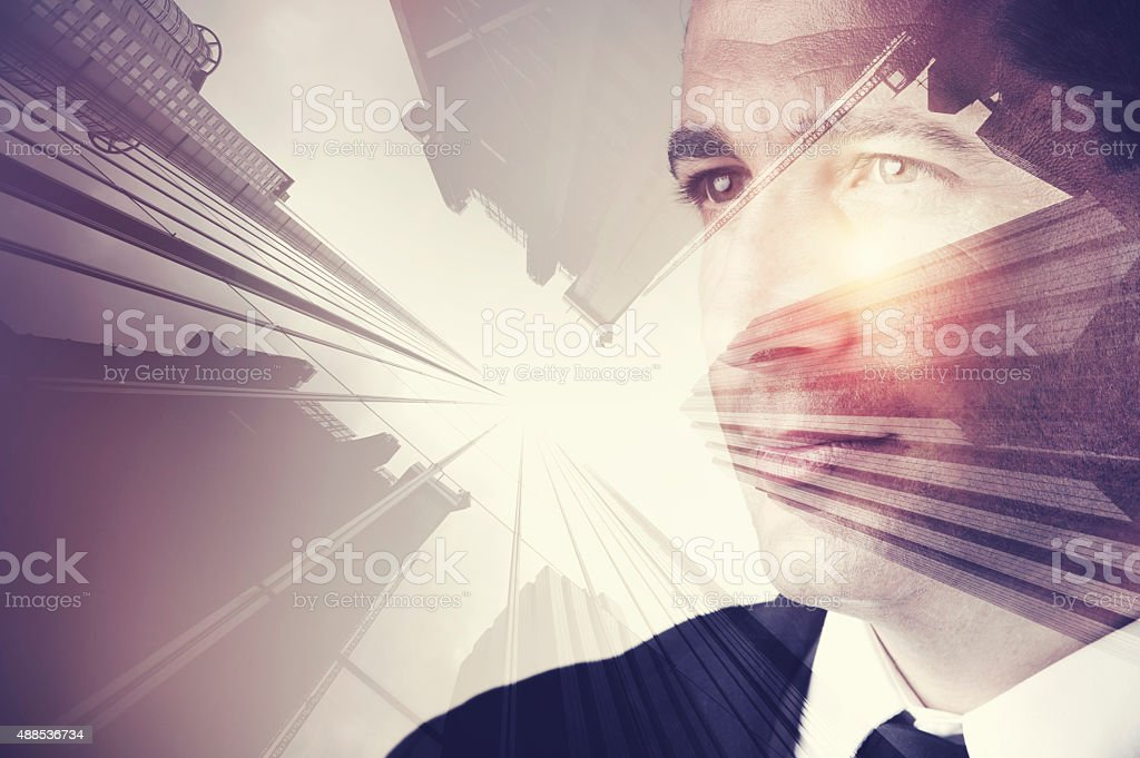 Business man in suit with cityscape montage. stock photo