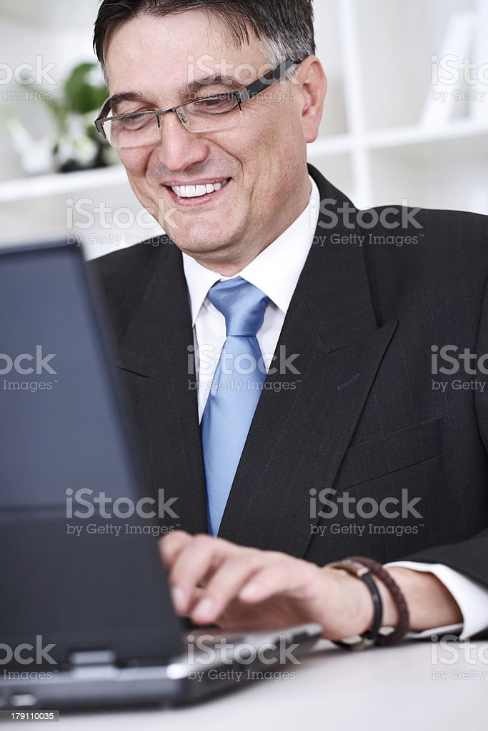 business man is working on  table with a laptop royalty-free stock photo