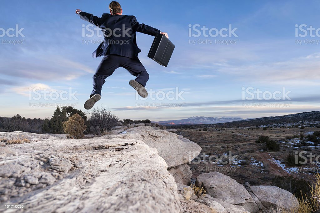 Business Man Jumping Excitedly in the Air royalty-free stock photo