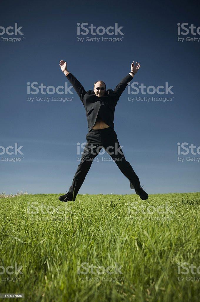 Business man jumping royalty-free stock photo