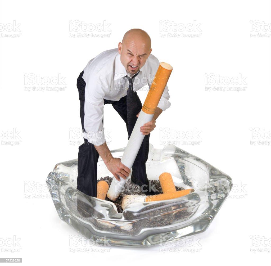Business Man Kicking the Smoking Habit royalty-free stock photo