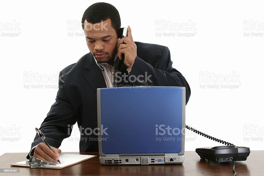 Business Man Laptop, Phone, Notes stock photo