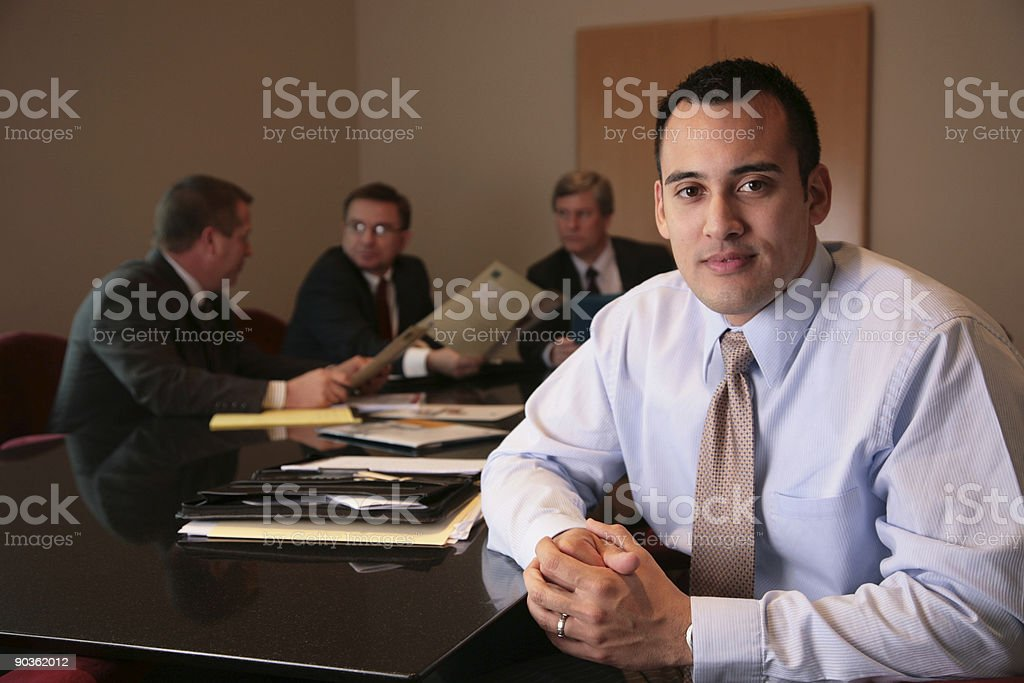 Business man leading his team at the office royalty-free stock photo