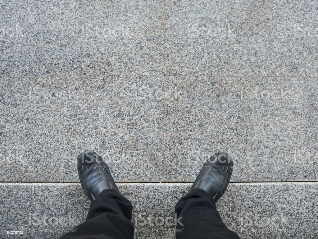 Business man look down to floor. royalty-free stock photo
