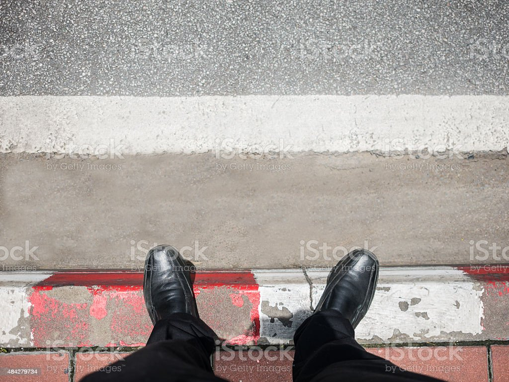Business man look down to street. stock photo