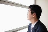 Business man look through window