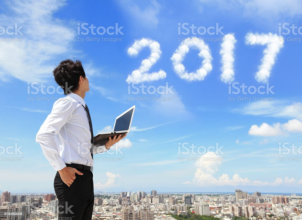 business man look to 2017 stock photo