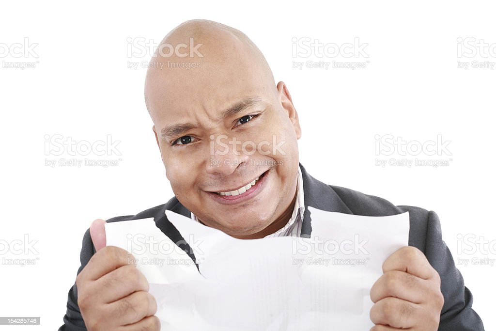 Business man looking angry tearing the stock pages royalty-free stock photo