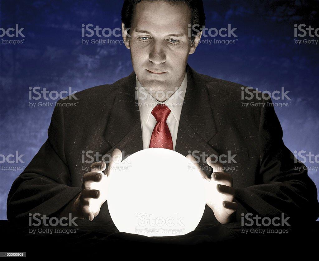 Business man looking at crystal ball stock photo