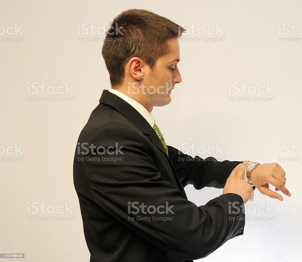 Business man looking at his watch royalty-free stock photo