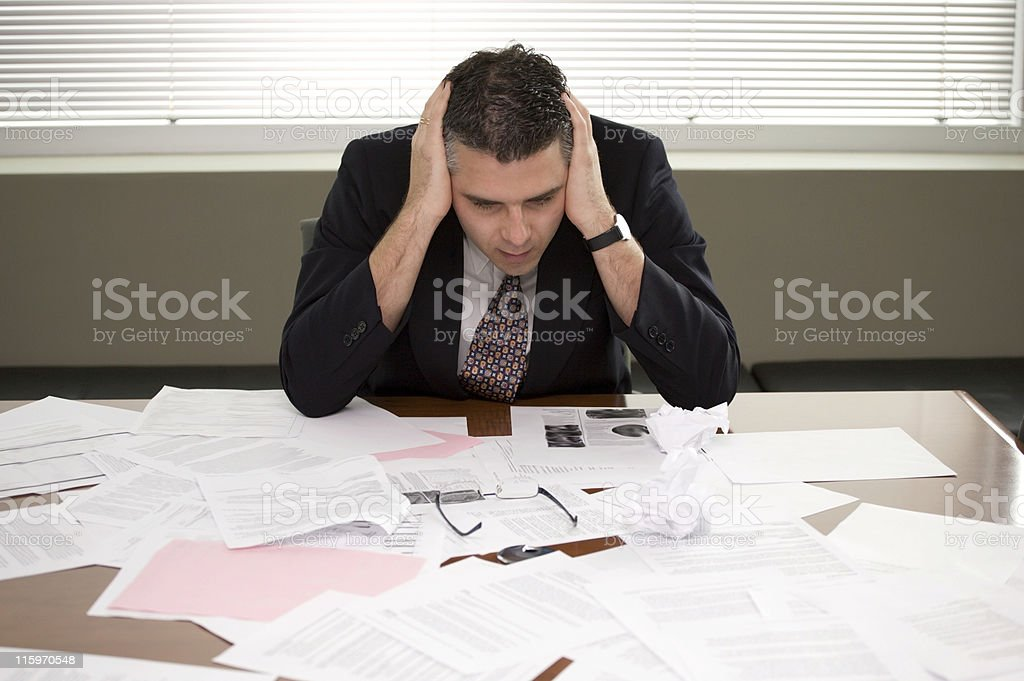 Business man looking at papers stock photo