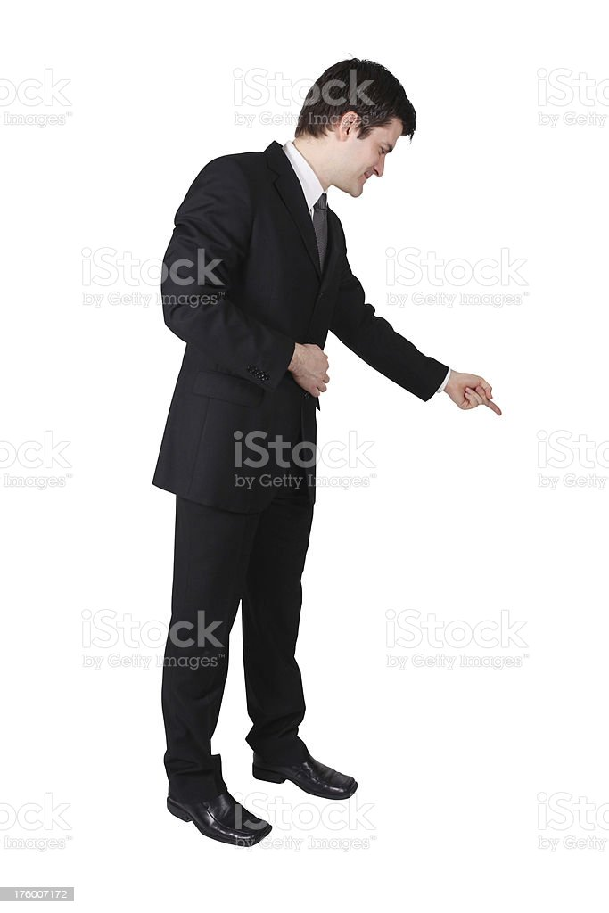 Business man looking away and pointing stock photo