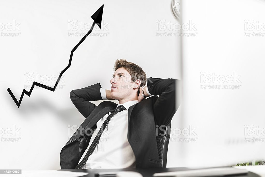 Business man looking the growth sitting at office stock photo