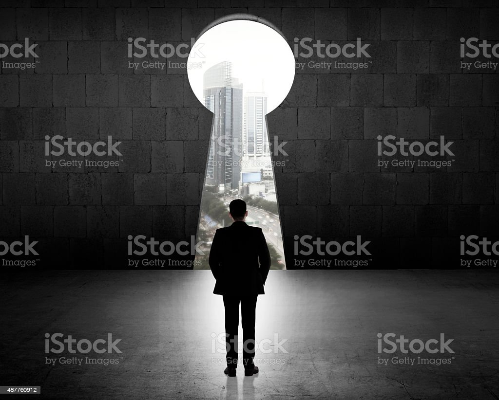 Business Man Looking Through Key Hole stock photo