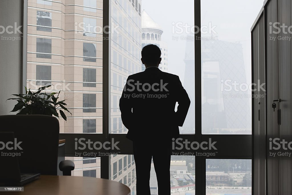 business man looking through windows royalty-free stock photo
