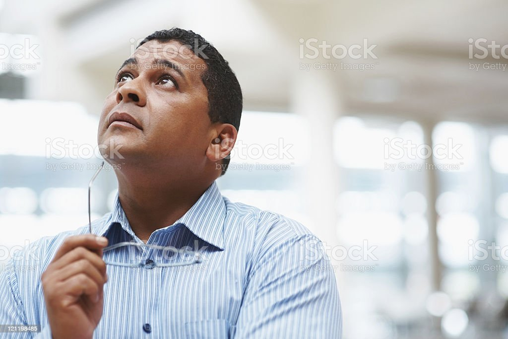 Business man looking up in thought royalty-free stock photo