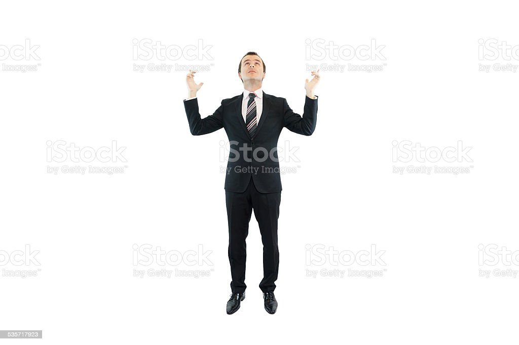 Business man looking up, questioning stock photo
