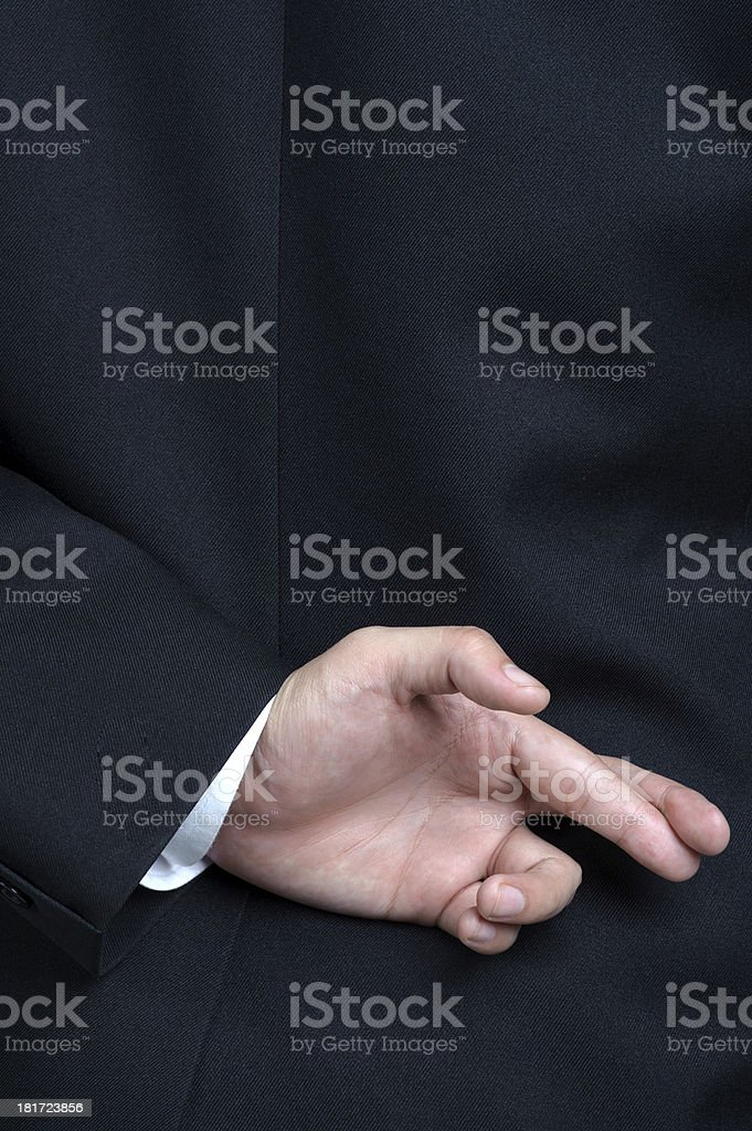 Business man lying fake Fingers Crossed stock photo
